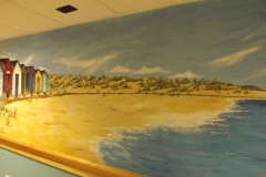 Coastal mural with beach huts