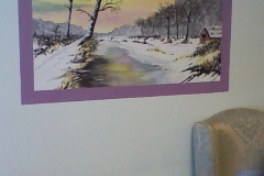 Snow scene mural in a frame