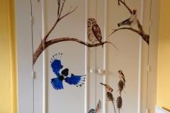 Wardrobe door painted with UK birds