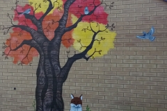 Tree mural with fox and pigeons