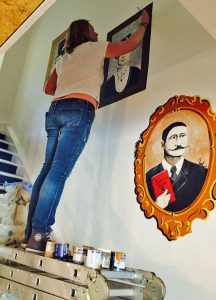 Sarah Hodgkins of Charlotte Designs painting a mural at 44 Harpur Street