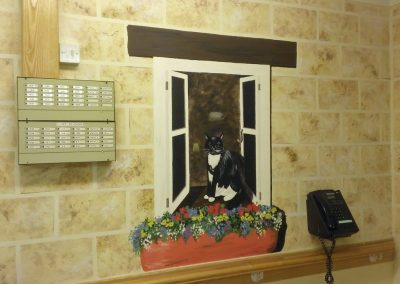 Trompe l'oeil window with cat and window box