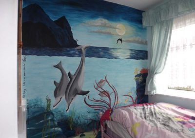 Girls underwater mural with dolphins