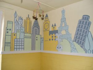 Collabortive mural depicting fmous buildings from around the world
