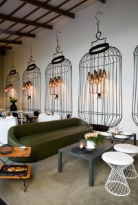 Repeated bird cage image on restaurant wall