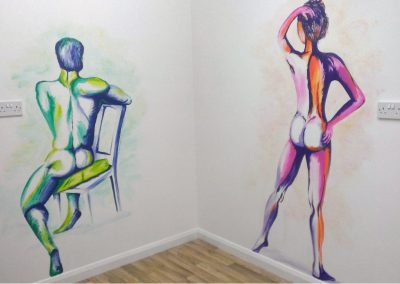 mural features male and female nudes