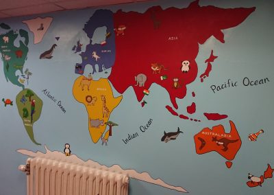 Image of world map mural for school entrance