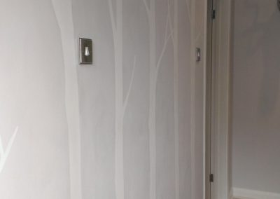 Image of simple white tree hallway mural