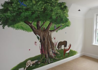 Tree mural with animals and fairies