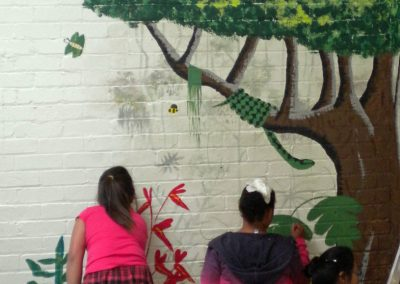 Image of children painting youth group mural