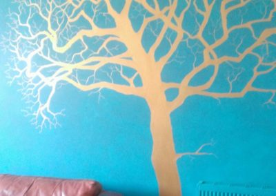 copper tree on teal background