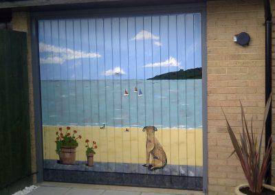 Image of garage door with seaside mural