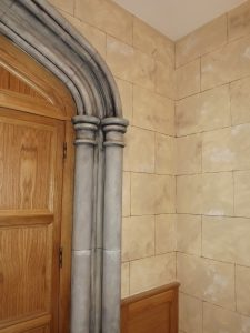 Faux stone wall and column