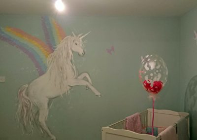 nursery with unicorn mural