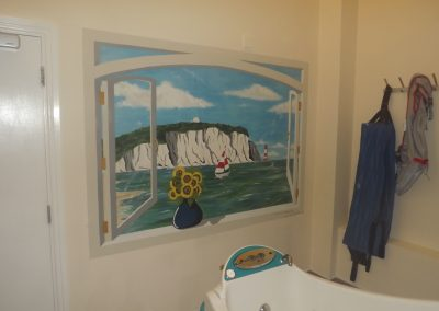painted window mural with coastal view