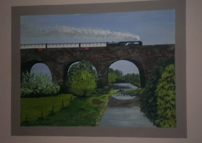 Viaduct mural with train