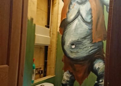 bathroom with troll mural
