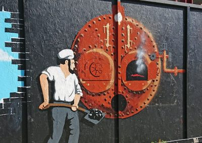 mural man stoking a boiler