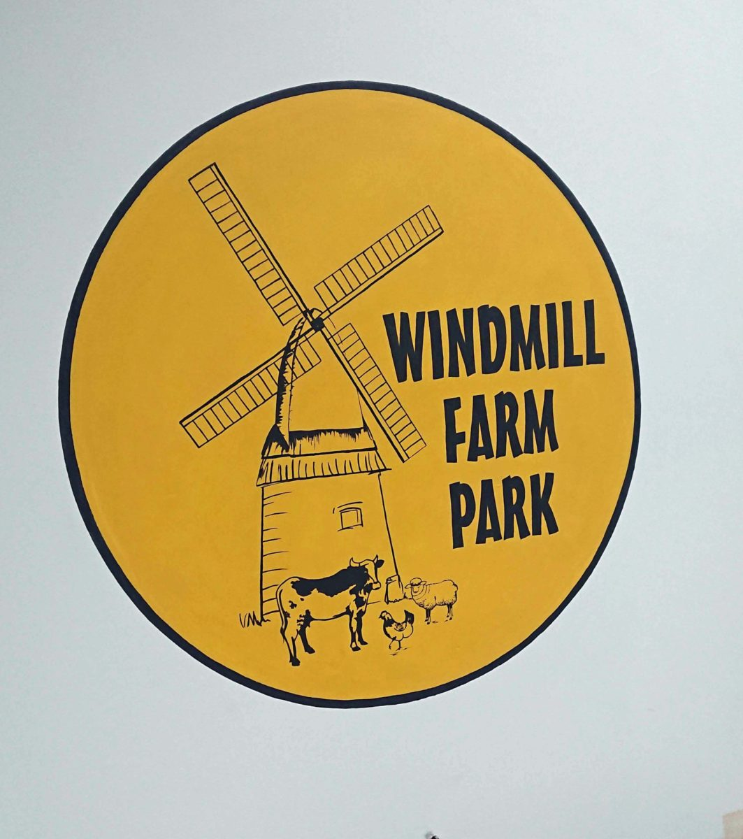 hand painted sign for Windmill Farm
