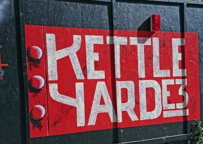 Image of hand painted hoarding sign for building site