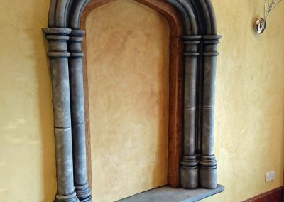 niche painted with travertino and faux oak and stone