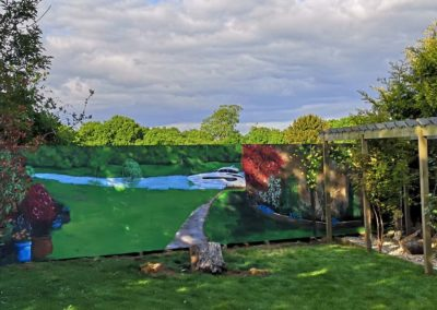 Garden mural of river and boat