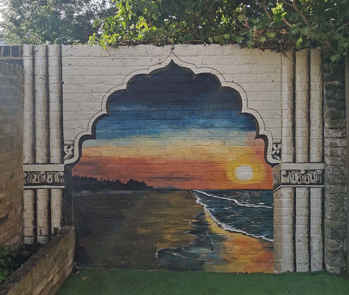 goan beach mural with temple frame