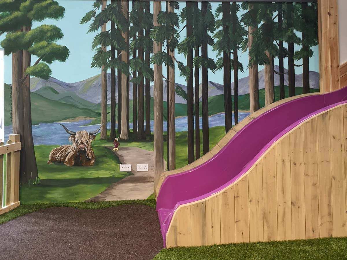Forest mural with Highland cow