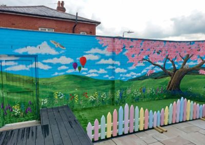 Garden mural with blossom tree