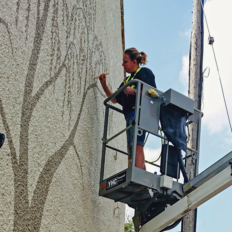 Mural painting in a cherry picker